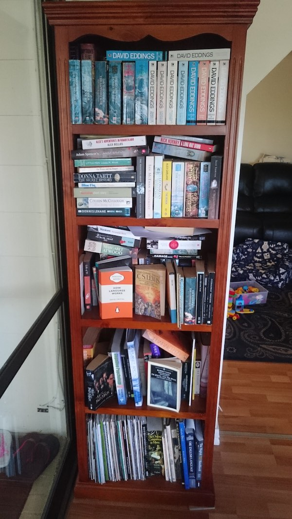 Another messy bookshelf