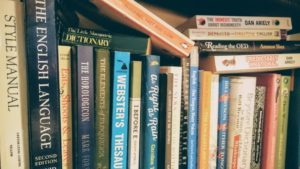 Books about writing and editing on a shelf