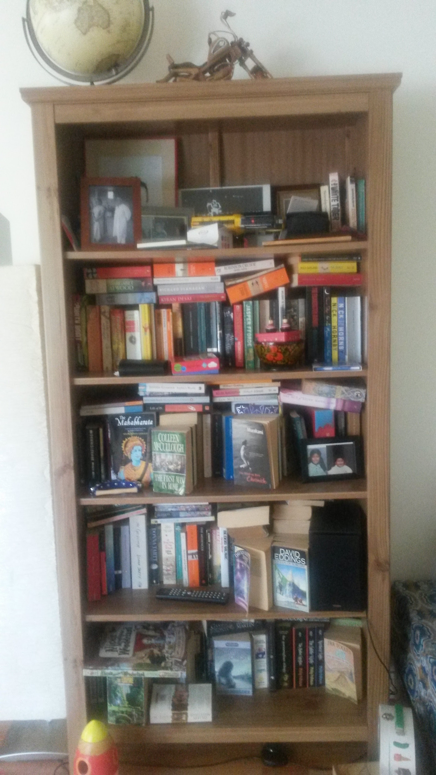 Messy bookshelf after cleanup